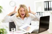 bigstock-Stressed-businesswoman-at-lapt-97005800