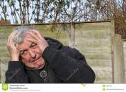 man-panic-attack-close-up-senior-his-hands-to-his-face-having-very-anxious-scared-53603349